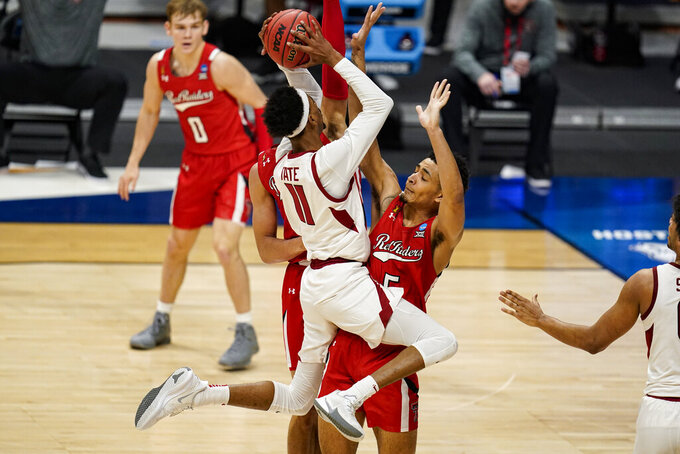 Arkansas guard Jalen Tate (11) shoots over Texas Tech guard Micah Peavy (5) in the first half of a second-round game in the NCAA men's college basketball tournament at Hinkle Fieldhouse in Indianapolis, Sunday, March 21, 2021. (AP Photo/Michael Conroy)