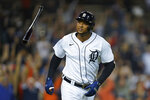 Detroit Tigers' Jonathan Schoop tosses his bat after hitting a grand slam against the Tampa Bay Rays in the seventh inning of a baseball game in Detroit, Friday, Sept. 10, 2021. (AP Photo/Paul Sancya)