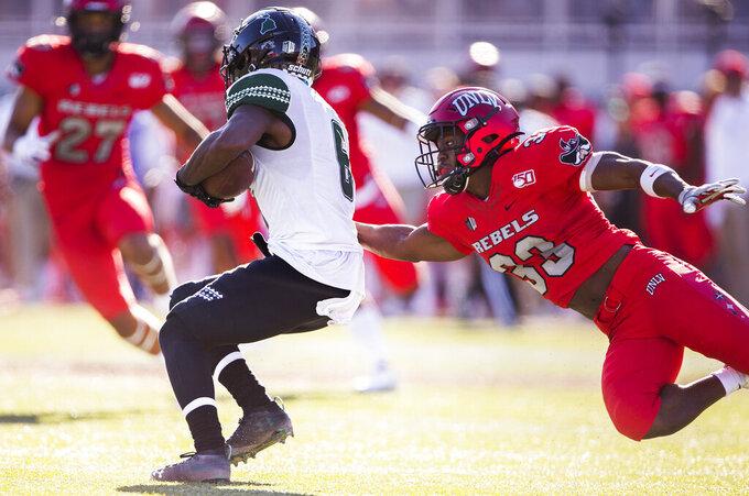 UNLV defensive back Sir Oliver Everett (33) tackles Hawaii wide receiver Cedric Byrd II (6) in the second quarter of an NCAA college football game Saturday, Nov. 16, 2019, in Las Vegas. (Benjamin Hager/Las Vegas Review-Journal via AP)