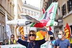 Workers of former Italian national flag carrier Alitalia demonstrate outside the Italian Parliament in downtown Rome, Friday, Sept. 10, 2021. The European Union's competition watchdog on Friday cleared an injection of Italian government funds into new national flag carrier ITA, and said the company would not be held accountable for illegal state aid given to its predecessor Alitalia. (Mauro Scrobogna /LaPresse via AP)