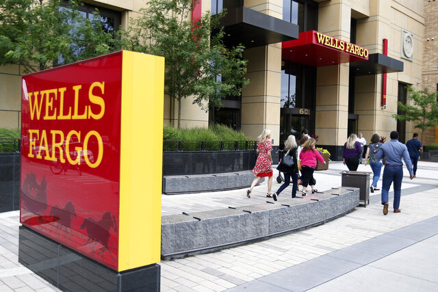 FILE - In this July 10, 2019, photo a Wells Fargo building is shown in downtown Minneapolis. Wells Fargo reported earnings of $2 billion on Wednesday, Oct. 14, 2020, less than half it made in the same period last year but a significant recovery from last quarter, when it lost $2.4 billion. (AP Photo/Jim Mone, File)