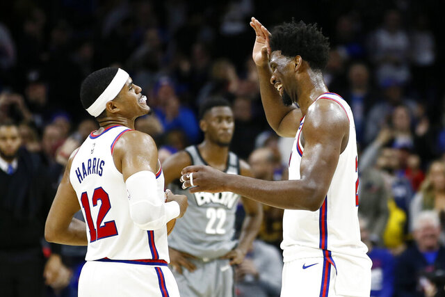 Philadelphia 76ers' Tobias Harris, left, and Joel Embiid celebrate during overtime in an NBA basketball game against the Brooklyn Nets, Thursday, Feb. 20, 2020, in Philadelphia. Philadelphia won 112-104. (AP Photo/Matt Slocum)