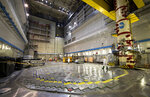 """In this photo taken on Tuesday, July 16, 2019, a worker walks on the Reactor 1 of Ignalina Nuclear Power Plant (NPP) in Visaginas some 160km (100 miles) northeast of the capital Vilnius, Lithuania. The HBO TV series """"Chernobyl"""" featuring Soviet era nuclear nightmares is drawing tourists to the atomic filming locations in Lithuania.(AP Photo/Mindaugas Kulbis)"""