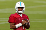 Miami Dolphins quarterback Tua Tagovailoa pauses during practice at the NFL football team's training facility, Tuesday, Sept. 22, 2020, in Davie, Fla. (AP Photo/Lynne Sladky)
