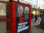 """A phone box displays a billboards showing Hungarian-American financier George Soros and EU Commission President Jean-Claude Juncker above the caption """"You have a right to know what Brussels is preparing to do!"""