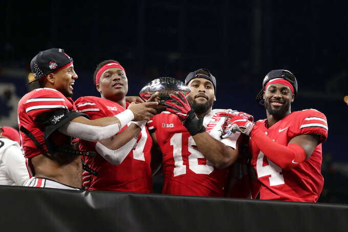 Ohio State's Keandre Jones, Dwayne Haskins, Jonathon Cooper and Jordan Fuller, from left, celebrate early Sunday, Dec. 2, 2018 after defeating Northwestern 45-24 in the Big Ten championship NCAA college football game in Indianapolis. Ohio State won 45-24. (AP Photo/Michael Conroy)