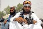 Taliban fighters pose for a photograph in the city of Kandahar, southwest Afghanistan, Sunday, Aug. 15, 2021. (AP Photo/Sidiqullah Khan)