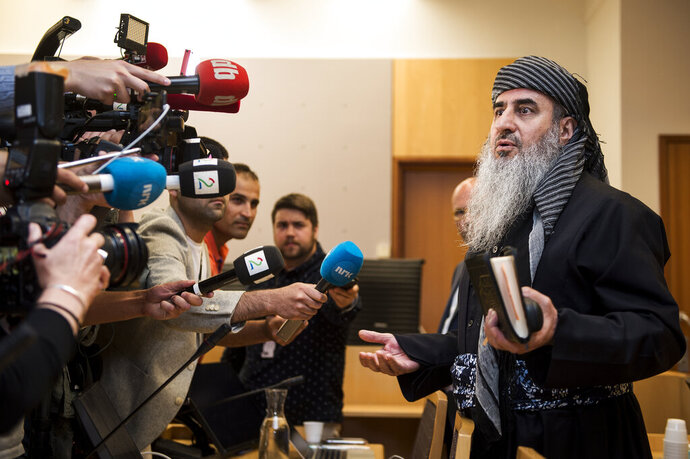 Mullah Krekar faces the media in a District Court in Oslo, Norway, Wednesday July 17, 2019. Norway's controversial refugee, Mullah Krekar, was seized Tuesday by the Norwegian police intelligence agency PST and held on the request of Italian authorities, after an Italian court sentenced him to 12-years in prison for planning terrorist acts. (Carina Johansen / NTB Scanpix via AP)