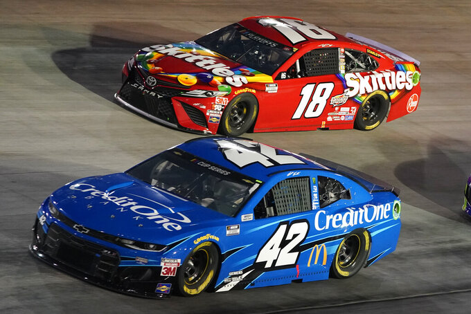 Matt Kenseth (42) and Kyle Busch (18) drive into Turn 1 during the NASCAR Cup Series auto race Saturday, Sept. 19, 2020, in Bristol, Tenn. (AP Photo/Steve Helber)