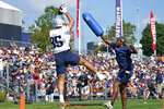 New England Patriots wide receivers coach Troy Brown, right, defends a pass to tight end Hunter Henry (85) during an NFL football practice, Friday, July 30, 2021, in Foxborough, Mass. (AP Photo/Elise Amendola)