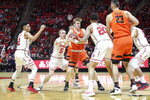 Oregon State guard Zach Reichle (11) grabs the ball while surrounded by Utah guards Sedrick Barefield (2) and Parker Van Dyke (5) and forwards Timmy Allen (20) and Novak Topalovic (13) during the first half of an NCAA college basketball game, Saturday, Feb. 2, 2019, in Salt Lake City. (AP Photo/Chris Nicoll)