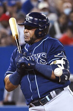 Tampa Bay Rays' Nelson Cruz is hit by a pitch from Toronto Blue Jays pitcher Jose Berrios during the sixth inning of a baseball game Tuesday, Sept. 14, 2021, in Toronto. (Jon Blacker/The Canadian Press via AP)