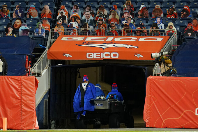 Buffalo Bills wide receiver Stefon Diggs exits the field on a cart during the second half of an NFL football game against the Denver Broncos, Saturday, Dec. 19, 2020, in Denver. Diggs returned to the sideline afterwards. (AP Photo/Jack Dempsey)