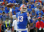 FILE - In this Oct. 6, 2018, file photo, Florida quarterback Feleipe Franks throws a pass against LSU during the first half of an NCAA college football game, in Gainesville, Fla. No. 7 Georgia plays at No. 9 Florida on Saturday. (AP Photo/John Raoux, File)
