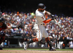 San Francisco Giants' Kevin Pillar connects for an RBI-single off Arizona Diamondbacks' Robbie Ray in the third inning of a baseball game Sunday, June 30, 2019, in San Francisco. (AP Photo/Ben Margot)