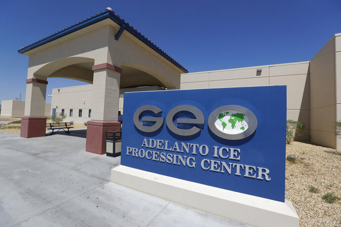 FILE - This Aug. 28, 2019, file photo shows the Adelanto U.S. Immigration and Enforcement Processing Center operated by GEO Group, Inc. (GEO) a Florida-based company specializing in privatized corrections in Adelanto, Calif. Speaking to investors last week, the founder of the private prison company GEO Group, which has been donating large sums to President Donald Trump and Republican candidates, predicted his company would rebound after the November election.  (AP Photo/Chris Carlson, File)
