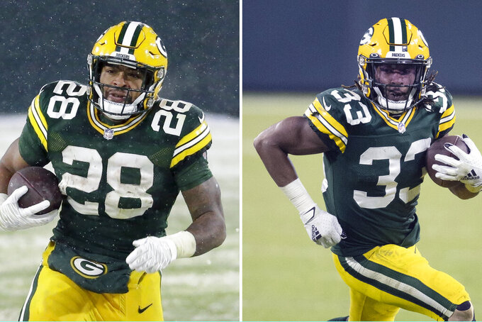 FILE -  At left, in a Dec. 27, 2020, file photo, Green Bay Packers' A.J. Dillon (28) runs for a touchdown during the second half of an NFL football game against the Tennessee Titans, in Green Bay, Wis. At right, in a Dec. 19, 2020, file photo, Green Bay Packers running back Aaron Jones (33) runs during an NFL football game against the Carolina Panthers, in Green Bay, Wis. Dillon says he and Jones could form the NFL's best running-back duo. (AP Photo/File)