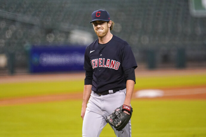 Cleveland Indians pitcher Shane Bieber smiles walking to the dugout in the fourth inning of a baseball game against the Detroit Tigers in Detroit, Thursday, Sept. 17, 2020. (AP Photo/Paul Sancya)