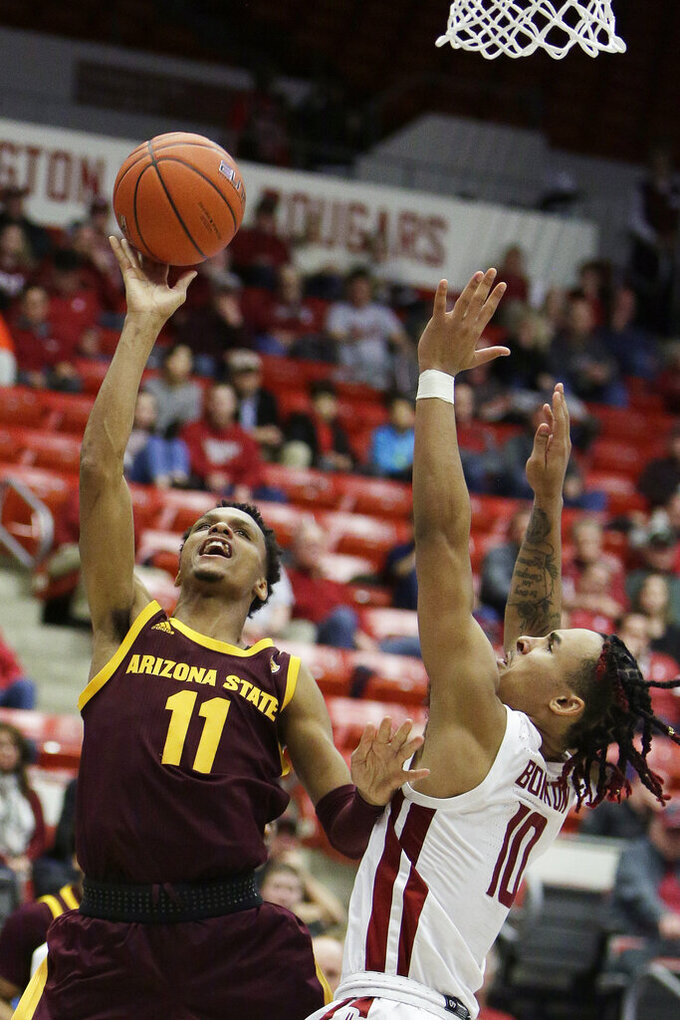 Arizona State guard Alonzo Verge Jr. (11) shoots next to Washington State guard Isaac Bonton (10) during the second half of an NCAA college basketball game in Pullman, Wash., Wednesday, Jan. 29, 2020. Washington State won 67-65. (AP Photo/Young Kwak)