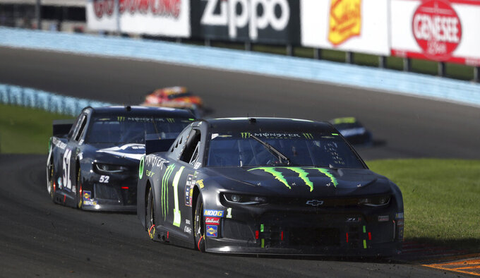 Kurt Busch competes in a NASCAR Cup Series auto race at Watkins Glen International, Sunday, Aug. 4, 2019, in Watkins Glen, N.Y. (AP Photo/John Munson)