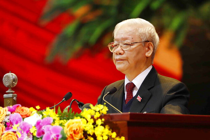 Vietnam Communist Party General Secretary Nguyen Phu Trong delivers a speech during the opening of 13th Communist Party Congress in Hanoi, Vietnam on Tuesday, Jan. 26, 2021. Vietnam's ruling Communist Party has begun a crucial weeklong meeting in the capital Hanoi to set the nation's path for the next five years and appoint the country's top leaders. (An Van Dang/VNA via AP)