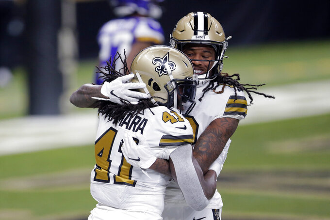 New Orleans Saints running back Alvin Kamara (41) celebrates his touchdown with wide receiver Marquez Calloway in the first half of an NFL football game against the Minnesota Vikings in New Orleans, Friday, Dec. 25, 2020. (AP Photo/Brett Duke)