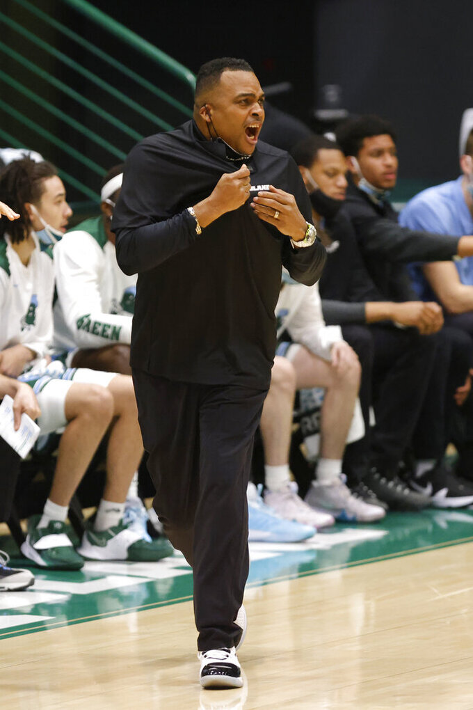 Tulane coach Ron Hunter reacts to a call during the first half of the team's NCAA college basketball game against Houston in New Orleans, Thursday, Jan. 28, 2021. (AP Photo/Tyler Kaufman)