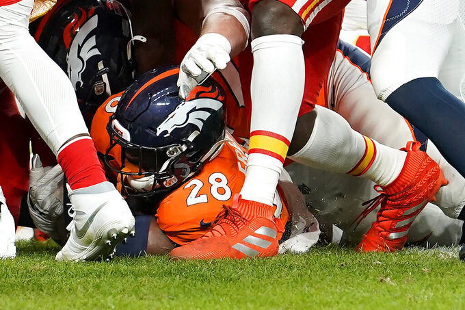 Denver Broncos running back Royce Freeman (28) crosses the goal line for a touchdown against the Kansas City Chiefs during the first half of an NFL football game, Thursday, Oct. 17, 2019, in Denver. (AP Photo/Jack Dempsey)