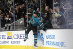 San Jose Sharks right wing Kevin Labanc (62) celebrates after scoring a goal against the Calgary Flames during the first period of an NHL hockey game in San Jose, Calif., Sunday, Oct. 13, 2019. (AP Photo/Jeff Chiu)