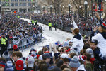Fans line Tremont Street before the New England Patriots parade through downtown Boston, Tuesday, Feb. 5, 2019, to celebrate their win over the Los Angeles Rams in Sunday's NFL Super Bowl 53 football game in Atlanta. (AP Photo/Michael Dwyer)