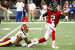 Atlanta Falcons quarterback Matt Ryan (2) escapes a tackle by Washington Redskins linebacker Josh Harvey-Clemons (40) during the first half an NFL preseason football game, Thursday, Aug. 22, 2019, in Atlanta. (AP Photo/John Bazemore)