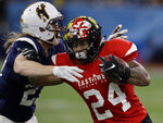 East running back Ty Johnson (24), of Maryland, is stopped by West safety Andrew Wingard (27), of Wyoming, on a run during the first half of the East West Shrine football game Saturday, Jan. 19, 2019, in St. Petersburg, Fla. (AP Photo/Chris O'Meara)