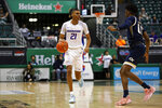 Boise State guard Derrick Alston (21) looks to get around Georgia Tech forward Khalid Moore (12) during the first half of an NCAA college basketball game Sunday, Dec. 22, 2019, in Honolulu. (AP Photo/Marco Garcia)