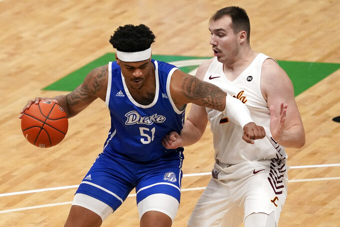 Drake's Darnell Brodie, left, heads to the basket as Loyola of Chicago's Cameron Krutwig defends during the first half of the championship game in the NCAA Missouri Valley Conference men's basketball tournament Sunday, March 7, 2021, in St. Louis. (AP Photo/Jeff Roberson)