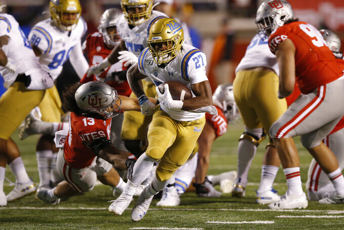 UCLA running back Joshua Kelley (27) carries the ball during the first half of the team's NCAA college football game against Utah on Saturday, Nov. 16, 2019, in Salt Lake City. (AP Photo/Rick Bowmer)