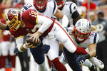 New England Patriots defensive end Chase Winovich (50) sacks Washington Redskins quarterback Colt McCoy (12) during the first half of an NFL football game, Sunday, Oct. 6, 2019, in Washington. (AP Photo/Patrick Semansky)
