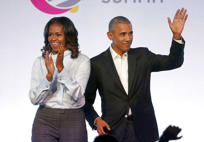 """FILE - In this Oct. 31, 2017, file photo, former President Barack Obama, right, and former first lady Michelle Obama appear at the Obama Foundation Summit in Chicago. Obama said in a commencement speech Sunday, June 7, 2020, that the nationwide protests following the recent deaths of unarmed black women and men including George Floyd were fueled from """"decades worth of anguish, frustration, over unequal treatment and a failure to perform police practices."""" (AP Photo/Charles Rex Arbogast, File)"""