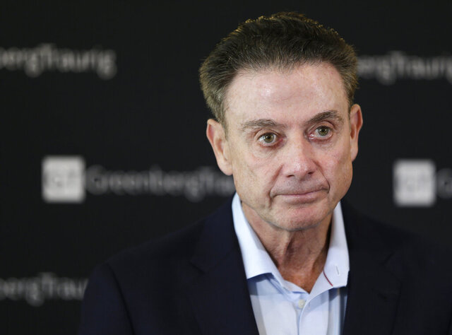 FILE - In this Feb. 21, 2018, file photo, former Louisville basketball Hall of Fame coach Rick Pitino talks to reporters during a news conference in New York. Louisville has received a notice of allegations from the NCAA that accuses the men's basketball program of committing a Level I violation with an improper recruiting offer and extra benefits and several Level II violations that accuse former Cardinals coach Rick Pitino of failing to promote an atmosphere of compliance. The notice released on Monday, May 4, 2020, is the completion of a two-year NCAA investigation following a federal corruption probe into college basketball.(AP Photo/Seth Wenig, File)