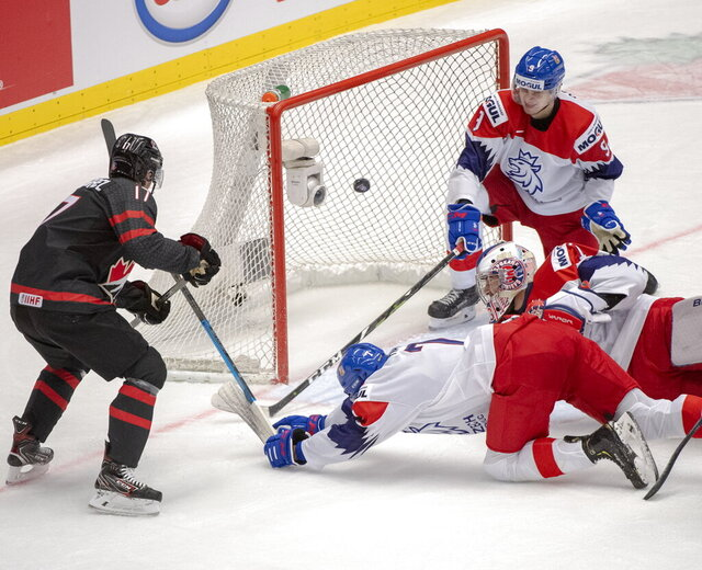 Canada's Connor McMichael scores Canada's fourth goal of the game as Czech Republic's Martin Has (7) goaltender Lukas Parik and Tomas Dajcar (9) look on during the first period at the World Junior Hockey Championships on Tuesday, Dec. 31, 2019 in Ostrava, Czech Republic. (Ryan Remiorz/The Canadian Press via AP)