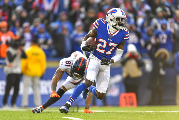 Buffalo Bills cornerback Tre'Davious White (27) avoids Denver Broncos wide receiver Tim Patrick (81) after intercepting a pass during the second quarter of an NFL football game, Sunday, Nov. 24, 2019, in Orchard Park, N.Y. (AP Photo/Adrian Kraus)