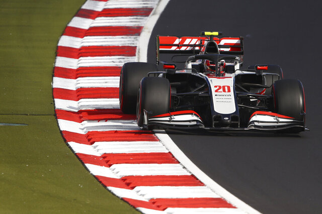 Haas driver Kevin Magnussen of Denmark steers his car during qualification for the Eifel Formula One Grand Prix at the Nuerburgring racetrack in Nuerburg, Germany, Saturday, Oct. 10, 2020. The Germany F1 Grand Prix will be held on Sunday. (Bryn Lennon, Pool via AP)