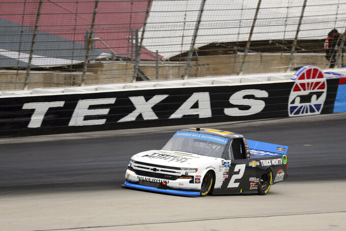NASCAR Texas Trucks Series driver Sheldon Creed (2) comes out of Turn 4 onto the front stretch during an auto race at Texas Motor Speedway in Fort Worth, Texas, Sunday, Oct. 25, 2020. (AP Photo/Richard W. Rodriguez)