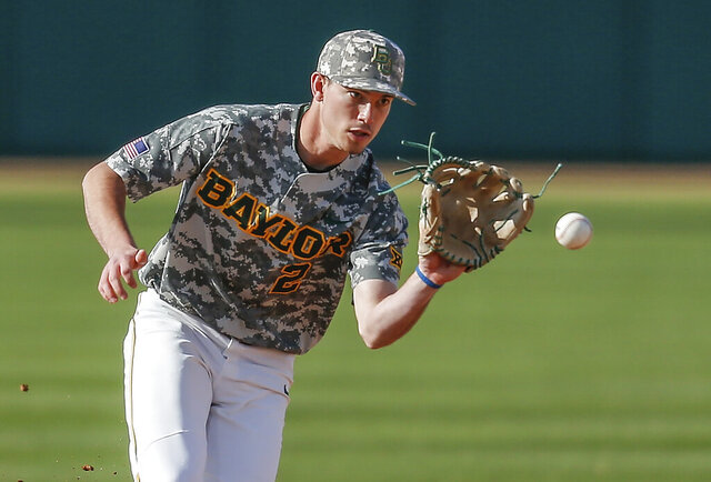 FILE - In this March 16, 2019, file photo, Baylor sophomore shortstop Nick Loftin fields a grounder during the team's NCAA college baseball game against Cal Poly in Waco, Texas. The Kansas City Royals selected Loftin in the draft Wednesday, June 10, 2020. (AP Photo/Brandon Wade, File)