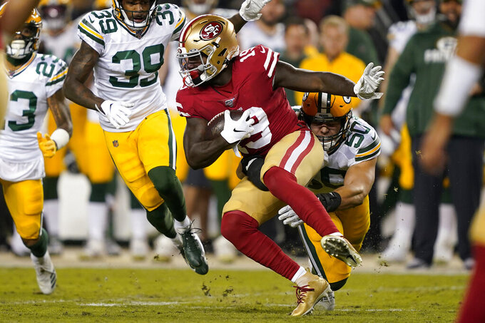 San Francisco 49ers wide receiver Deebo Samuel (19) runs against Green Bay Packers inside linebacker Blake Martinez (50) during the first half of an NFL football game in Santa Clara, Calif., Sunday, Nov. 24, 2019. (AP Photo/Tony Avelar)