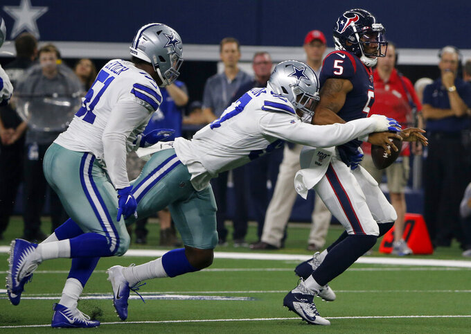 Dallas Cowboys' Kerry Hyder (51) and Taco Charlton, center, chase down Houston Texans' Joe Webb (5) who scrambles out of the pocket in the first half of a preseason NFL football game in Arlington, Texas, Saturday, Aug. 24, 2019. (AP Photo/Michael Ainsworth)