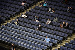 The stands inside FedExForum are mostly empty in the first half of an NBA preseason basketball game between the Atlanta Hawks and the Memphis Grizzlies, Thursday, Dec. 17, 2020, in Memphis, Tenn. (AP Photo/Brandon Dill)