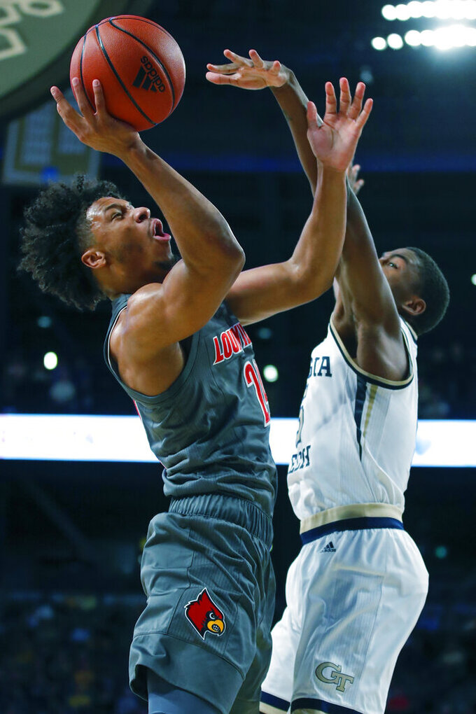 Louisville forward Dwayne Sutton (24) is fouled by Georgia Tech forward Moses Wright (5) during the second half of an NCAA college basketball game in Atlanta, Wednesday, Feb. 12, 2020. (AP Photo/Todd Kirkland)