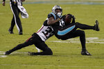 Carolina Panthers wide receiver Curtis Samuel is tackled by Atlanta Falcons cornerback Blidi Wreh-Wilson during the second of an NFL football game Thursday, Oct. 29, 2020, in Charlotte, N.C. (AP Photo/Gerry Broome)