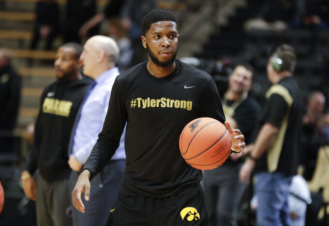 Iowa guard Isaiah Moss (4) wears a shirt honoring Tyler Trent before an NCAA college basketball game against Iowa in West Lafayette, Ind., Thursday, Jan. 3, 2019. Both Purdue and Iowa will pay their respects to late Boilermakers fan Tyler Trent on by wearing #TylerStrong T-shirts in his honor. Trent, a superfan who inspired people across the globe during his hard-fought battle with cancer, died this week. He was 20. (AP Photo/Michael Conroy)