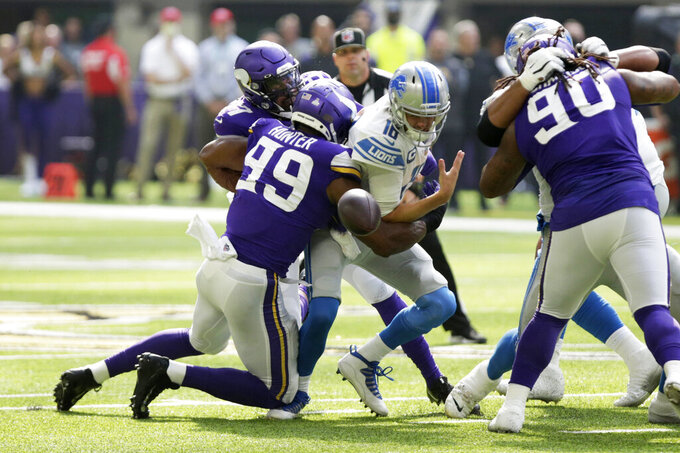 Detroit Lions quarterback Jared Goff (16) fumbles the ball as he is hit by Minnesota Vikings defensive end Danielle Hunter (99) during the first half of an NFL football game, Sunday, Oct. 10, 2021, in Minneapolis. (AP Photo/Andy Clayton-King)